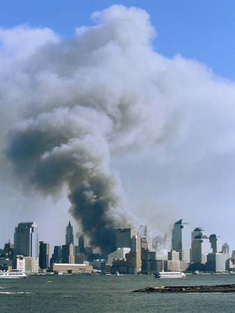 Smoke Billows over Manhattan after the September 11, 2001 Attack Stretched Canvas Print