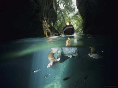 An Archeologist Swims Via an Entrance into the Mayan Underworld Stretched Canvas Print