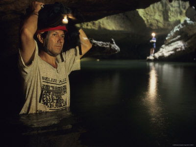 An Archeologist Stands Inside the Cave Stretched Canvas Print