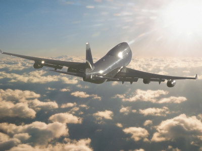 Jumbo Jet Above Clouds Into Sunlight Stretched Canvas Print