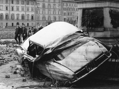 Automobile Destroyed and Flung up Against a Monument During the Flood in Florence Stretched Canvas Print