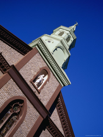 Statue and Steeple on Church of Transfiguration in Chinatown, New York City, New York, USA Stretched Canvas Print