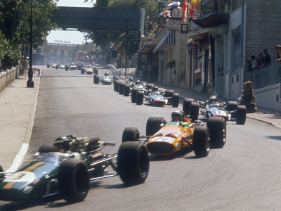 1968 Monaco Grand Prix, Jochen Rindt in Brabham leads Bruce McLaren in McLaren-Ford Stretched Canvas Print