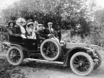 1907 Mercedes with Occupants in Edwardian Dress Stretched Canvas Print