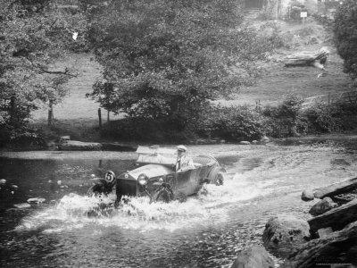 1925 Lancia Lambda Driving Through a Shallow River Stretched Canvas Print