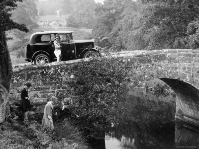 1930 Triumph Super 7 on a Stone Bridge in Rural England, 1930's Stretched Canvas Print