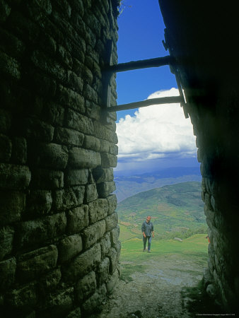 An Archeologist Studies the Entrance to Kuelap a Chachapoyan Fortress Stretched Canvas Print