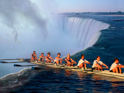 Rowers Hang Over the Edge at Niagra Falls, US-Canada Border Stretched Canvas Print