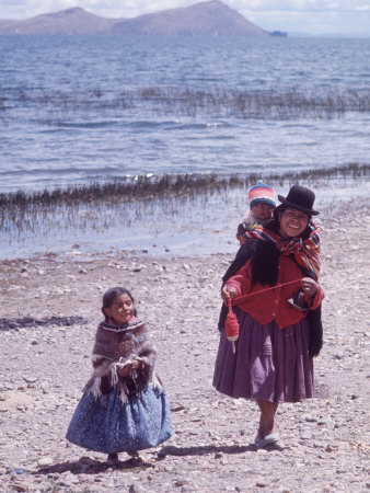 Mother and Two Children Holding Ball of Yarn, Andean Highlands of Bolivia Stretched Canvas Print