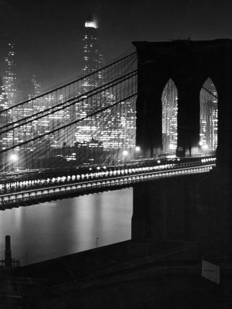 Glittering Night View of the Brooklyn Bridge Spanning the Glassy Waters of the East River Stretched Canvas Print