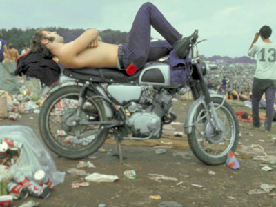 Shirtless Man in Levi Strauss Jeans Lying on Motorcycle Seat at Woodstock Music Festival Stretched Canvas Print