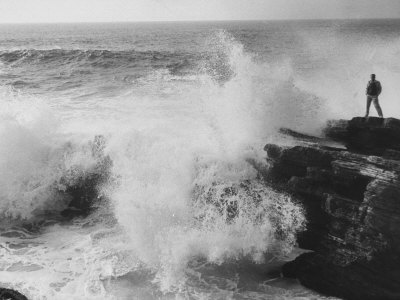 Oceanographer Willard Bascom Standing on a Rock while Observing the Crashing Surf Stretched Canvas Print