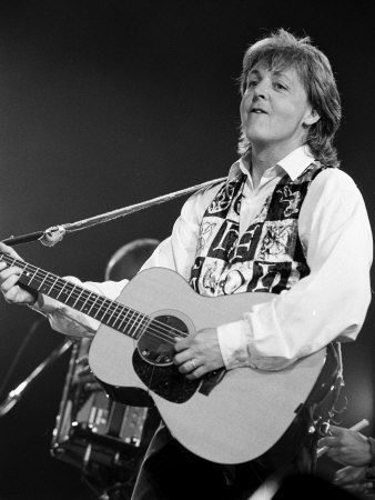 Paul McCartney Playing Guitar on Stage Stretched Canvas Print