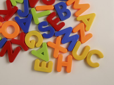 Pile of Multicolored Alphabet Magnets Stretched Canvas Print