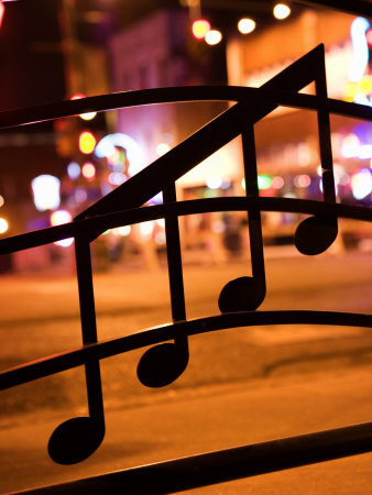 Nighttime View of Beale Street in Memphis, Tennessee Through Musical Notes on a Window Stretched Canvas Print