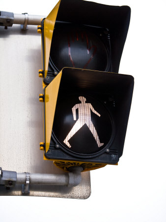 Illuminated Crosswalk Sign Warning Pedestrians of Crossing Street Stretched Canvas Print