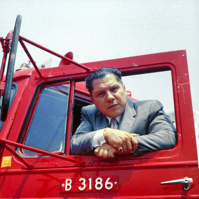 Portrait of Teamsters Union Pres. Jimmy Hoffa Leaning Out Window of Red Truck Stretched Canvas Print