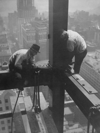 Workmen Attaching Steel Beams High Above Street During Construction of Manhattan Company Building Stretched Canvas Print