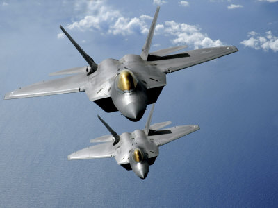 Two F-22 Raptors Fly over the Pacific Ocean Stretched Canvas Print