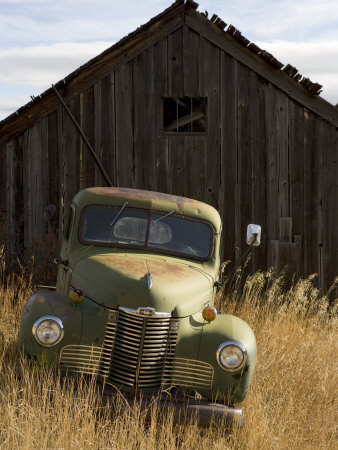 Abandoned Pick-Up Truck in Front of an Old Shed, Marysville, Montana Stretched Canvas Print