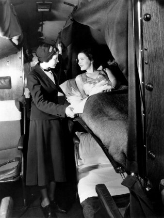 American Airlines Stewardess Checks on Passenger in Sleeper Airplane, 1935 Stretched Canvas Print