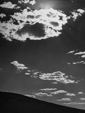 Sunshine Filled Clouds Against Dark Sky, Above Dark Dune in Middle of Kalahan Desert, Bechuanaland Stretched Canvas Print