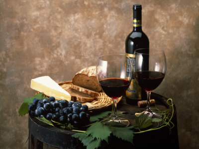 Still Life of Wine Bottle, Wine Glasses, Cheese and Purple Grapes on Top of Barrel Stretched Canvas Print