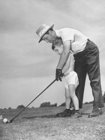 Father Teaching His Small Son How to Play Golf Stretched Canvas Print