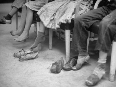 Stamping their Feet, Children from the Avondale Camp Wait to Be Fitted with Free Shoes Stretched Canvas Print
