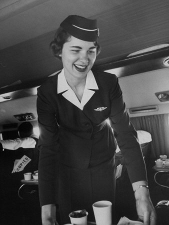 Airline Stewardess Seving Coffee Stretched Canvas Print