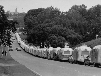 Long Line of Airstream Trailers Wait for Parking Space at a Campground During a Trailer Rally Stretched Canvas Print
