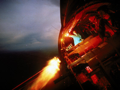 Crew of Us Ac-47 Plane Firing 7.62 Mm Ge Miniguns During Night Mission in Vietnam Stretched Canvas Print