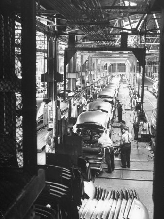 Employees Working on Cars as They Move Down Assembly Line Stretched Canvas Print