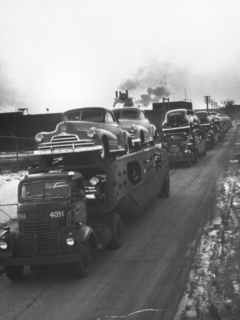 Newly-Made Pontiacs Being Transported on Trucks Stretched Canvas Print