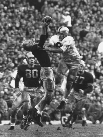 Violent Action: Don Helleder Trying to Retrieve Ball from Navy Defense During Army-Navy Game Stretched Canvas Print