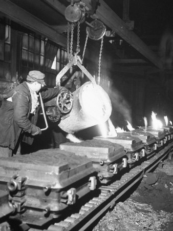 Worker Pouring Hot Steel into Molds at Auto Manufacturing Plant Stretched Canvas Print