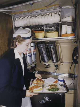 Flight Attendant Sets Up a Passengers Meal on United Airlines Stretched Canvas Print