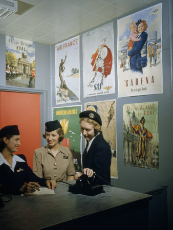 Flight Attendants Stand and Talk Beneath Airline Advertising Posters Stretched Canvas Print