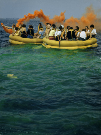 Flight Attendants Wearing Life Vests Take Part in a Life Raft Drill Stretched Canvas Print