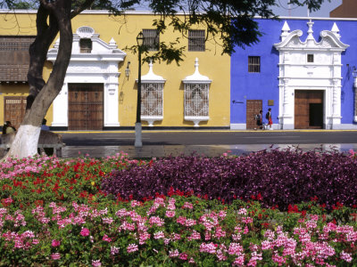 Pastel Shades and Wrought Iron Grillwork Dominate Colonial Architecture in Centre of Trujillo, Peru Stretched Canvas Print