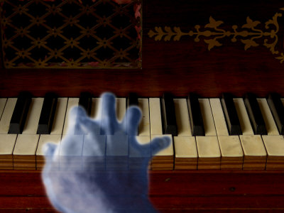 Ghost Hand Playing the Piano Stretched Canvas Print