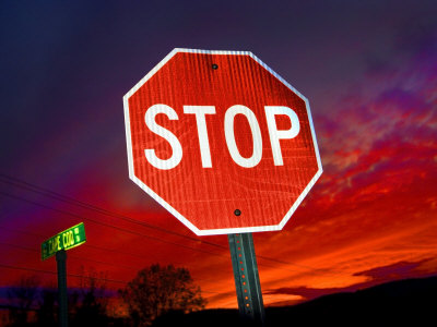 Stop Sign with an Intense Red Sunset in the Backround Stretched Canvas Print