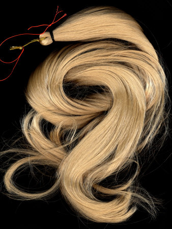 A Lock of Blonde Synthetic Hair Stretched Canvas Print