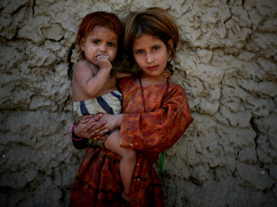 Afghan Girl Holds Her Younger Sister in Nangarhar Province, East of Kabul, Afghanistan Stretched Canvas Print