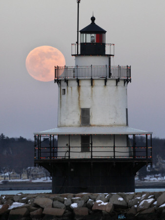 Full Moon Rises Behind the Spring Point Light House in South Portland, Maine Stretched Canvas Print