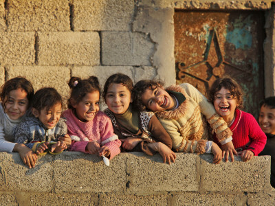 Palestinian Girls Giggle While Photographed Where Shell from an Israeli Gunboat Landed Earlier Stretched Canvas Print