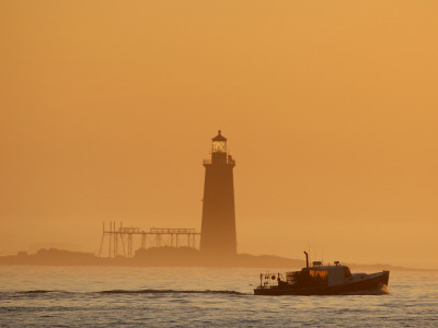 Lobster Boat Passes Ram Island Ledge Light at Dawn Off Cape Elizabeth, Maine Stretched Canvas Print