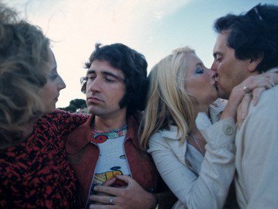 retro couples smooching 1970s