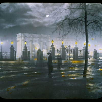 Marble Arch by Night - a Figure Standing in Front of the Park Gates Stretched Canvas Print