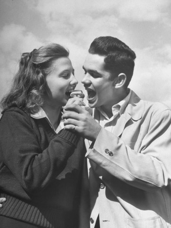 Boy and Girl Eating an Ice Cream Cone Together Stretched Canvas Print